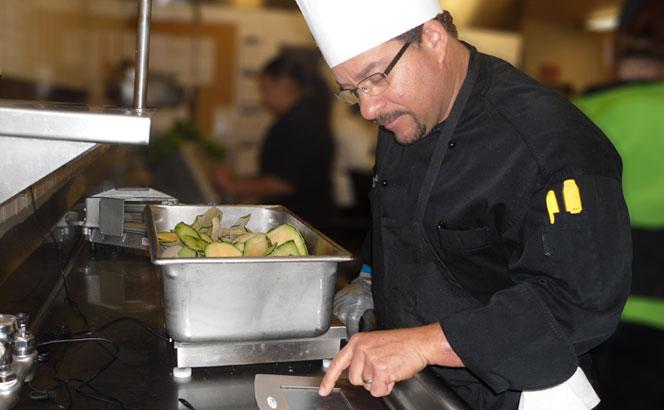 Executive Chef Tim Cunningham using LeanPath software.