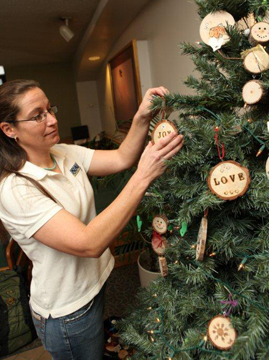 Cheryl Miller decorating a tree