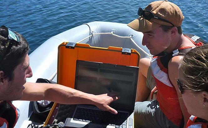 Students use acoustic imaging to select a coring site in southern Alaska lake. Credit/permission D. Kaufman