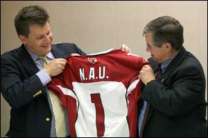 Micheal Bidwill giving John Haeger a Cardinals' jersey