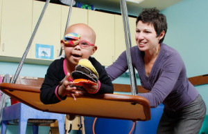 Occupational therapist works with a patient.