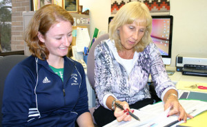 A social work student being advised by field work coordinator Mary Damskey.