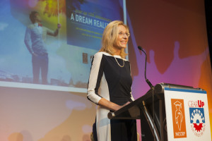 Teena Olszewski speaks at the podium at the event