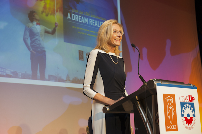 Teena Olszewski speaks at the podium at the event