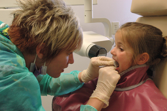 Dental hygiene student with a patient.