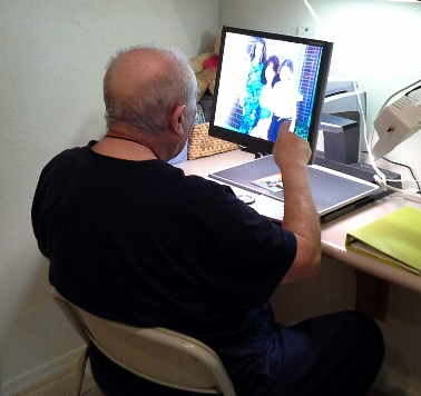 Elderly man uses a video magnifier