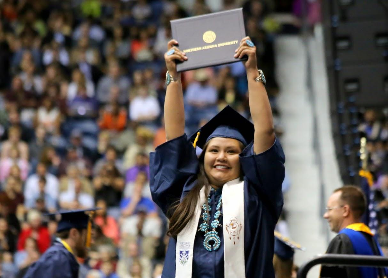 Native American grad raises degree