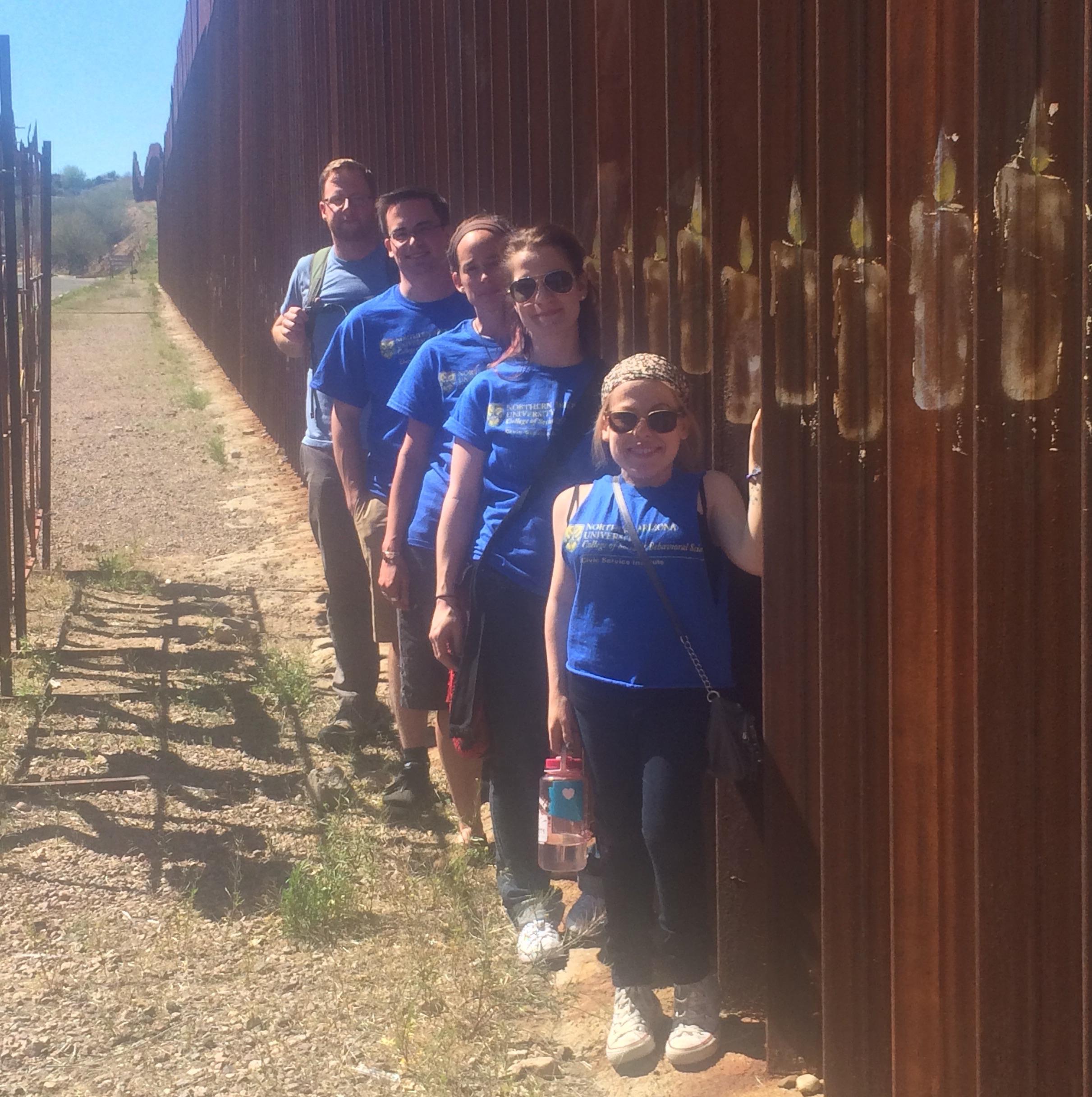 NAU students along the border fence