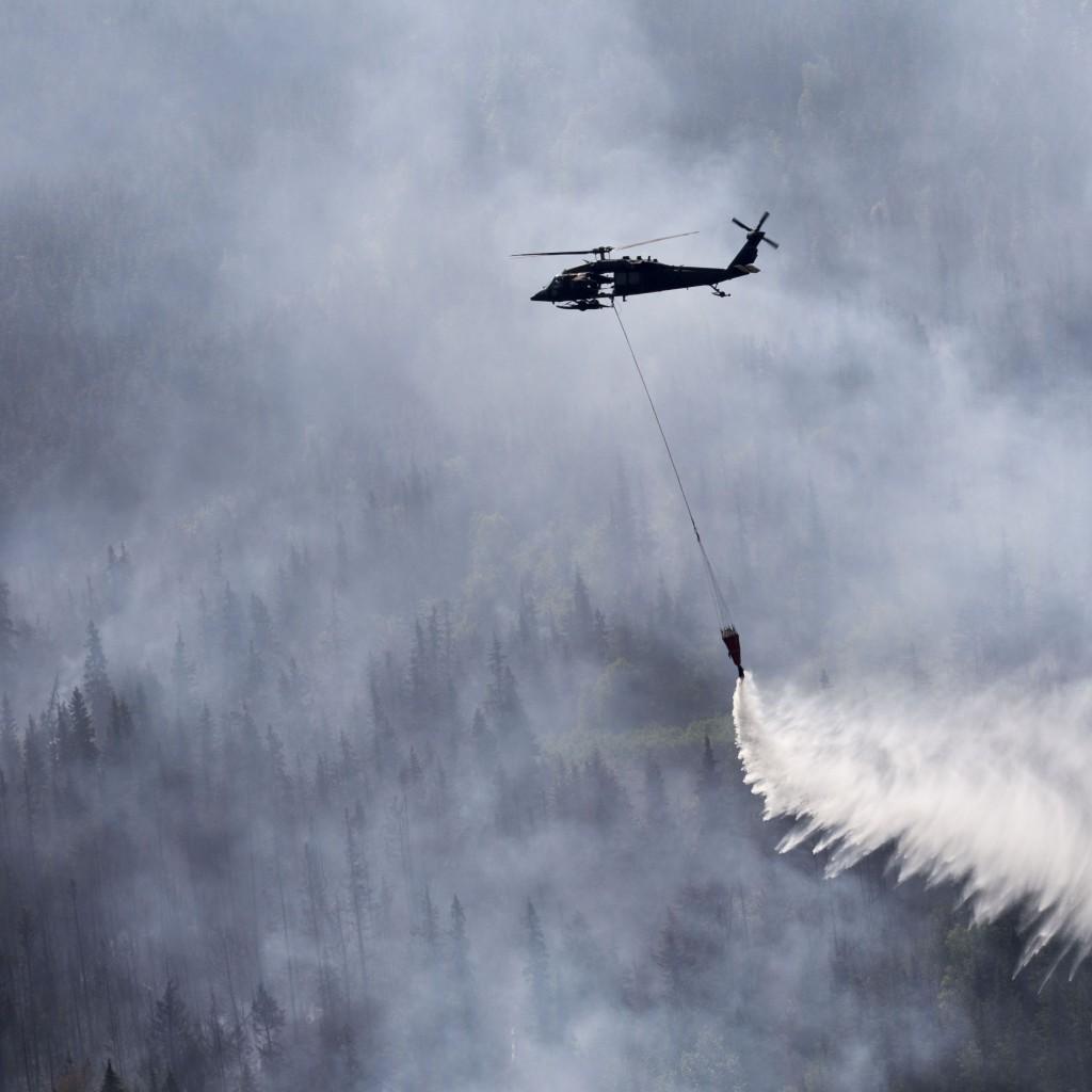 A Black Hawk drops water on the Stetson Creek Fire in Alaska