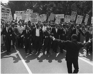 Civil rights marchers parade down the street.