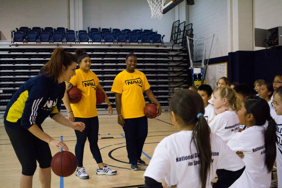women's basketball members interact with youth