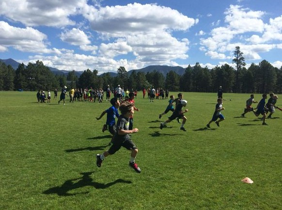 the kids race down the field