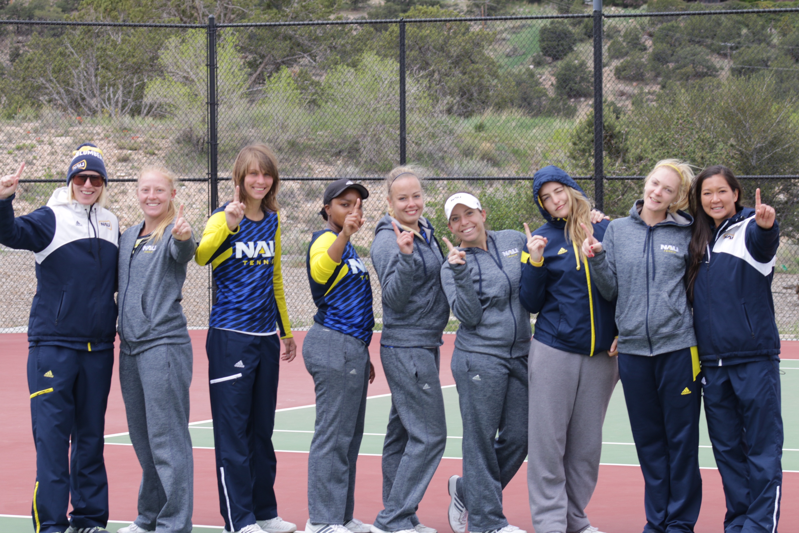 Women's tennis members on the court