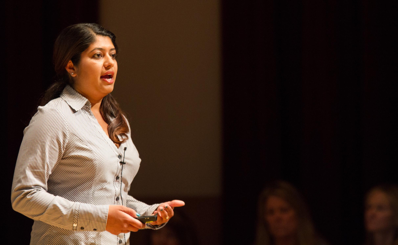 grad student Uzma Tahir gives a speech