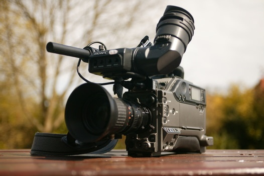 A video camera set down outside