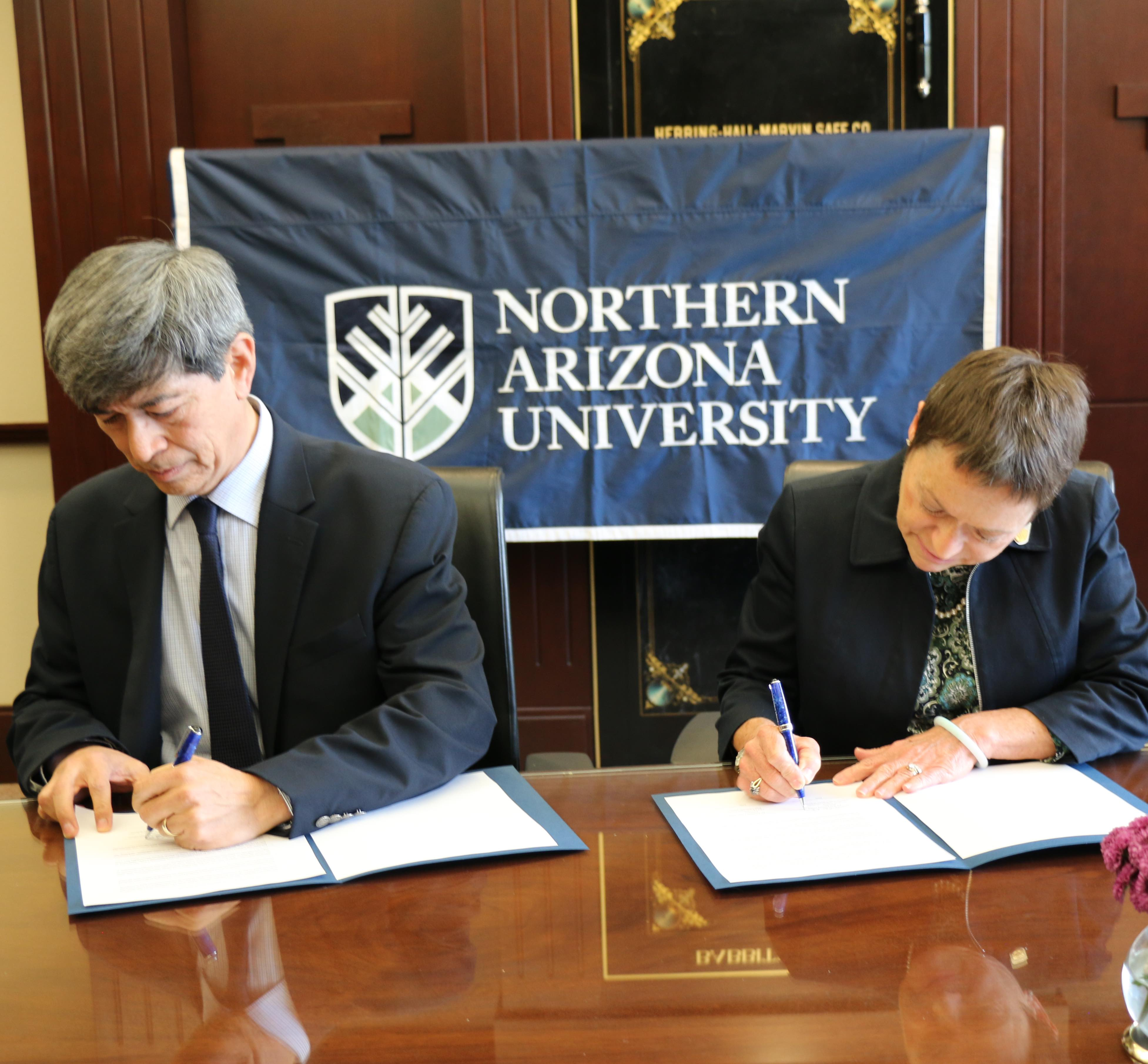 NAU President Rita Cheng signs a memorandum of understanding next to CETYS President Fernando León García