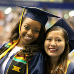 Two graduates during Spring 2016 commencement ceremony