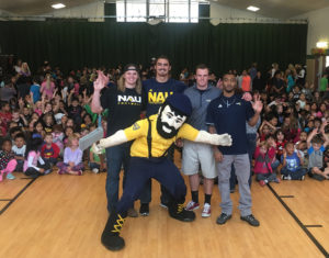 NAU student-athletes and Louie the Lumberjack join Flagstaff area elementary school students at an assembly.