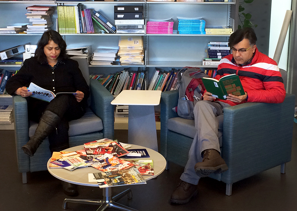 Two teachers from India read books