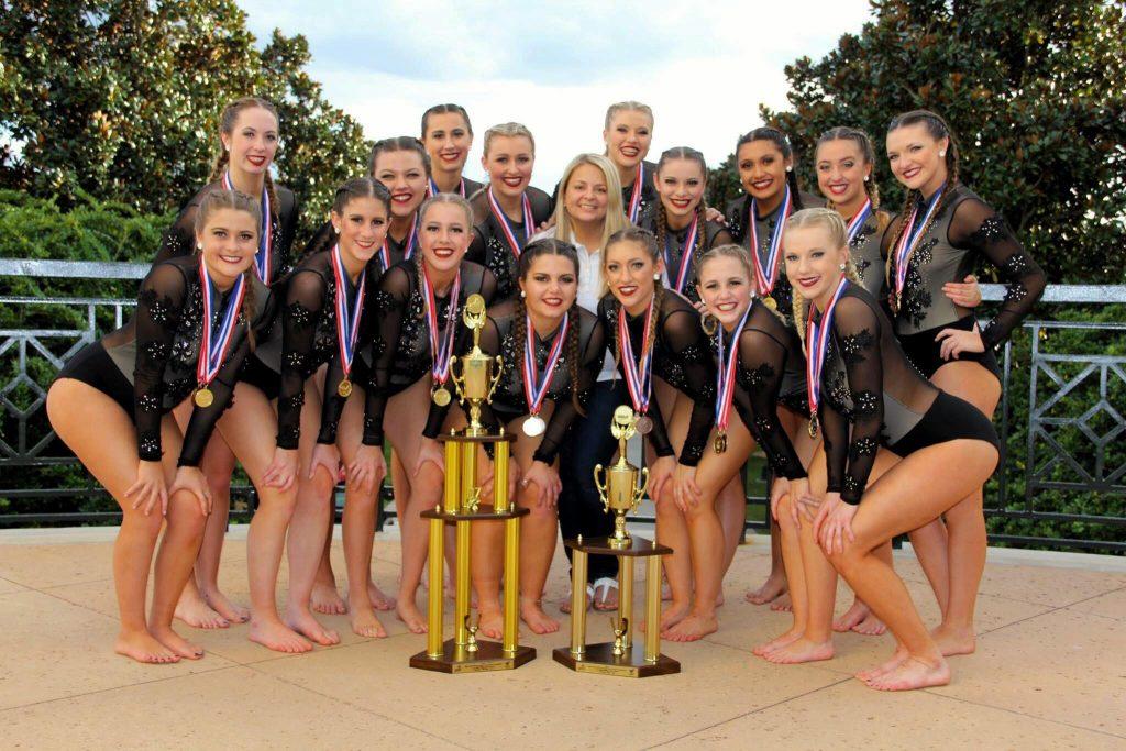 NAU Dance team poses with trophies