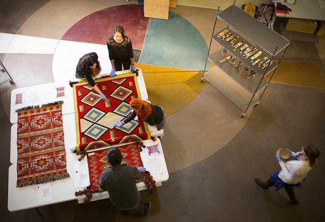 Students examine Navajo rug