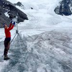 Graduate student Ellie Broadman takes samples on a glacier