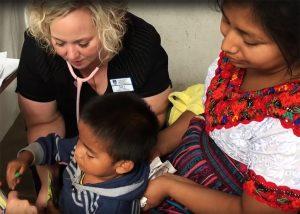 Nursing student treats young Guatemalan boy
