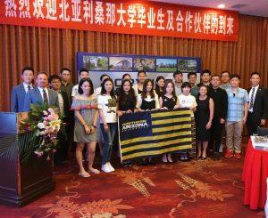 Cheng poses with NAU alumni
