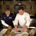 Mitch Strohman and Chef Mark Mulinaro roll sushi