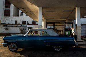 A man fuels his car near the Malecón in Havana, Cuba.