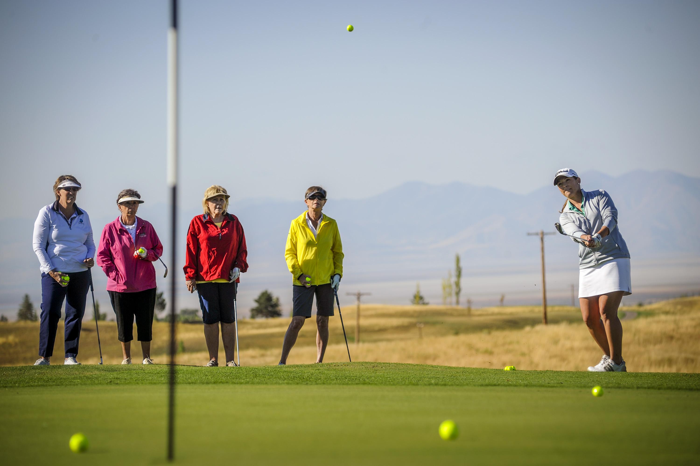 Women play golf