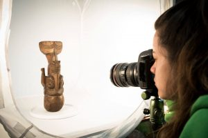 Rapa Nui student photographing artifact