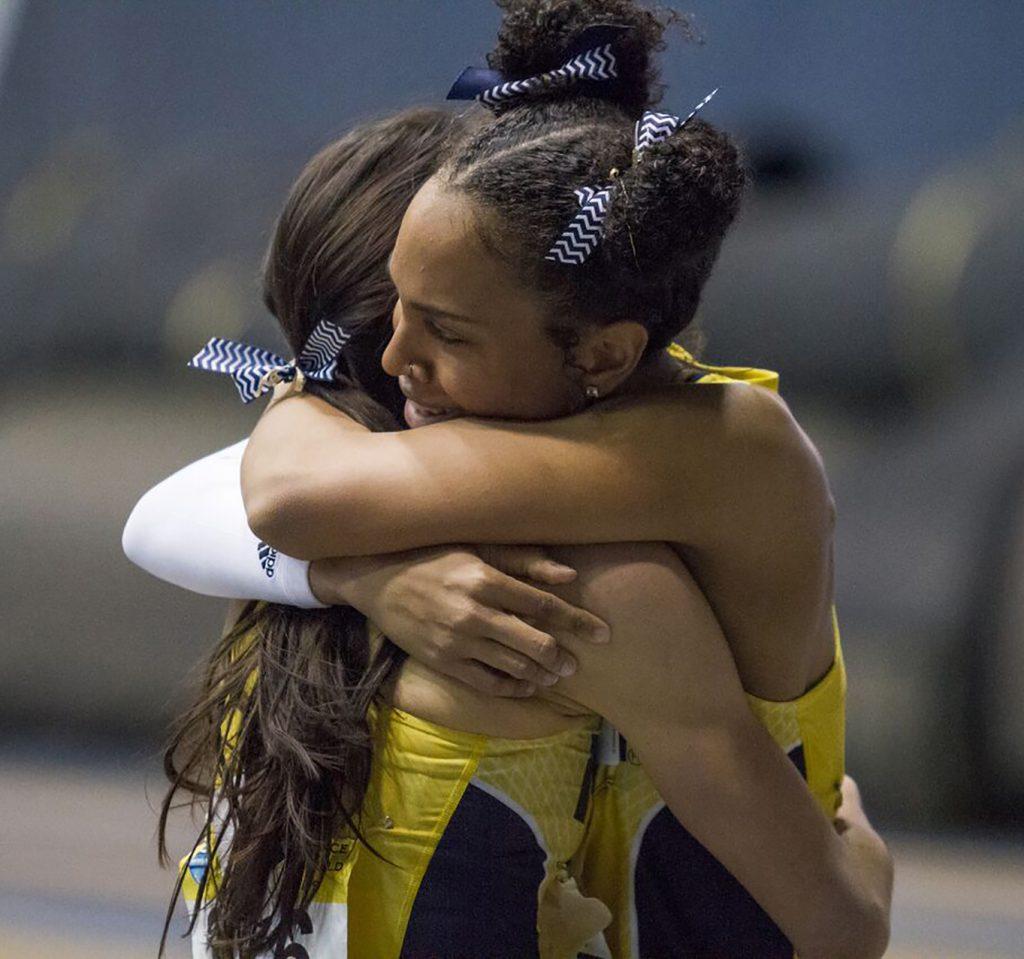 Jasmine Malone hugs teammate