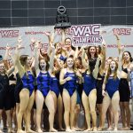 NAU Swimming and Diving team poses with trophy