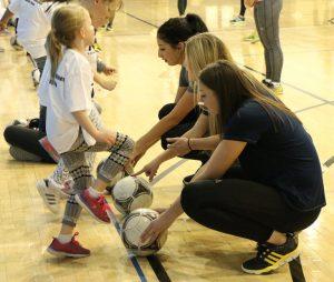 Women in sports teaching the clinic