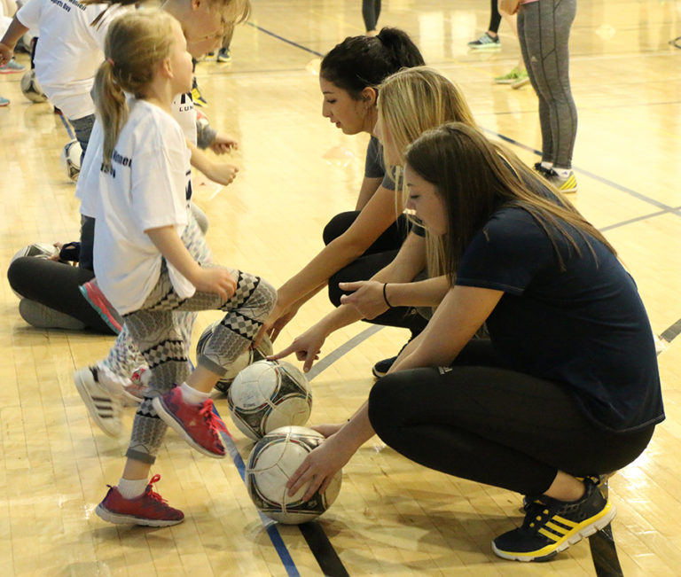 Women in sports teaching the clinic