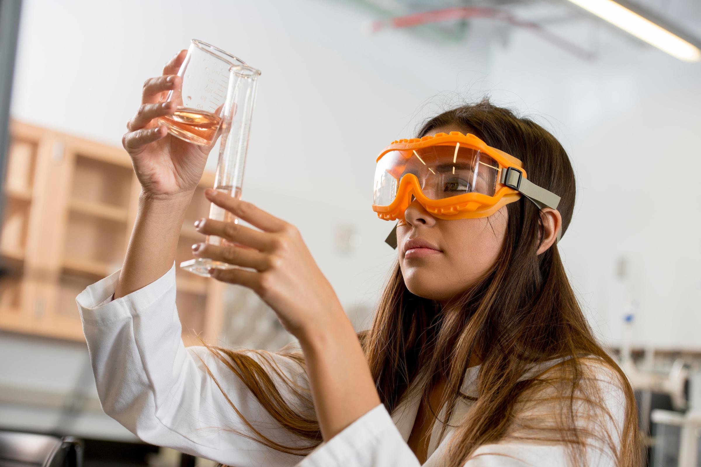Female NAU student working in chemistry lab