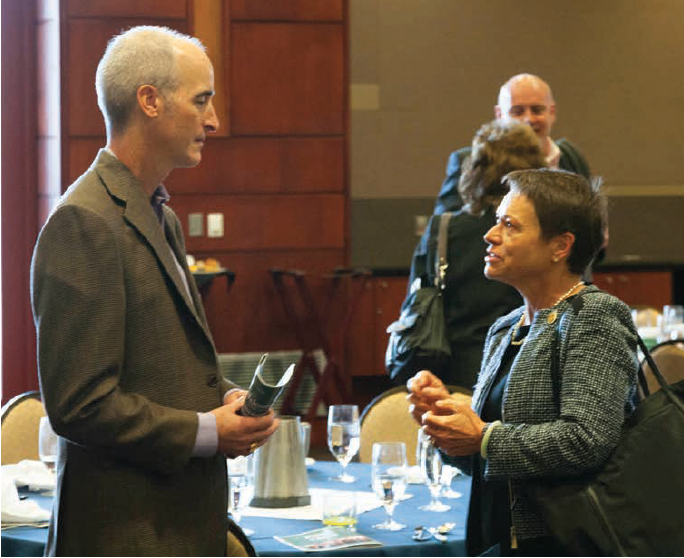 David Franke and President Cheng converse
