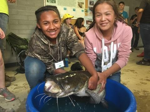 Girls with catfish