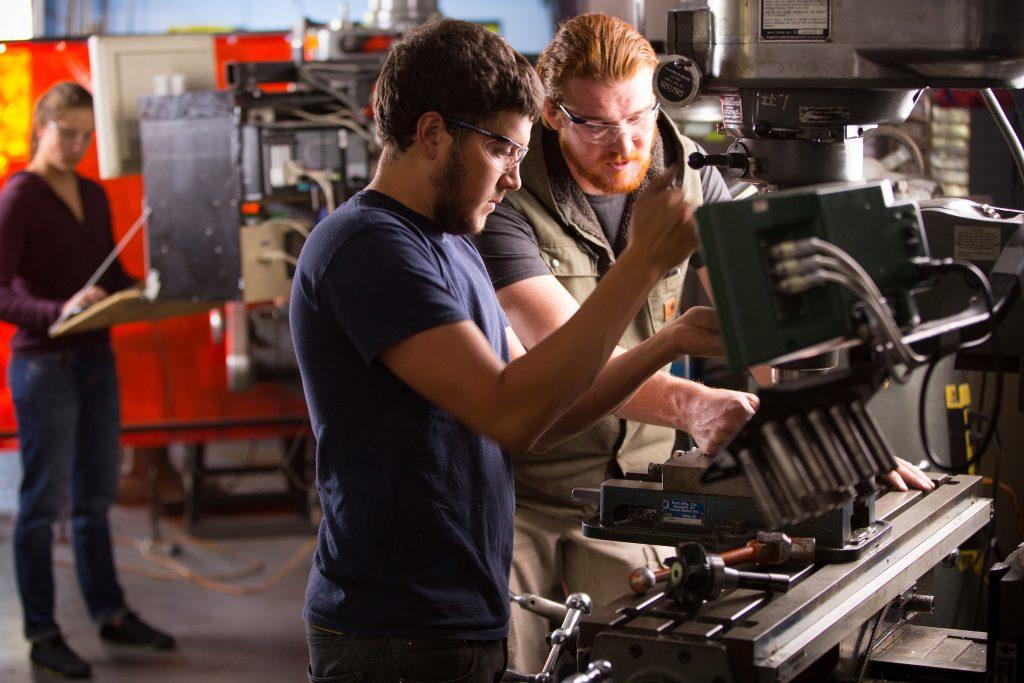 Engineering students run machine