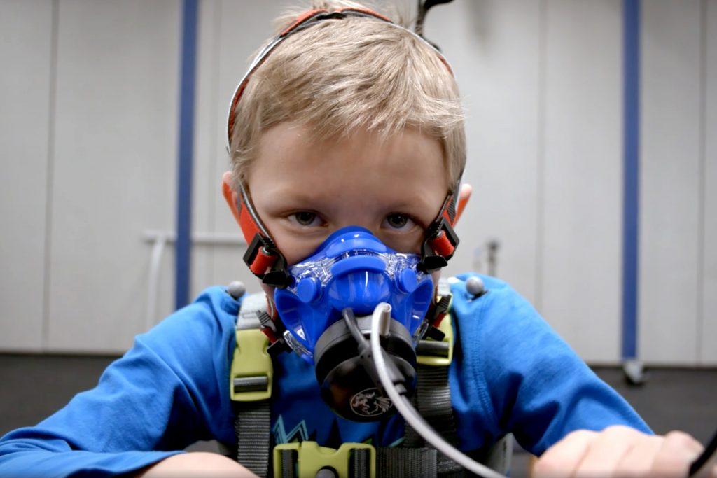 Boy wears exoskeleton