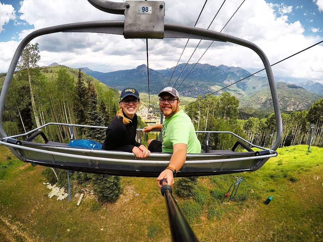 lumberjacks ride a chairlift in Colorado