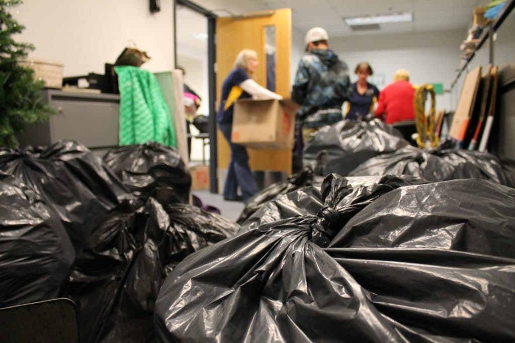 Volunteers sort clothes