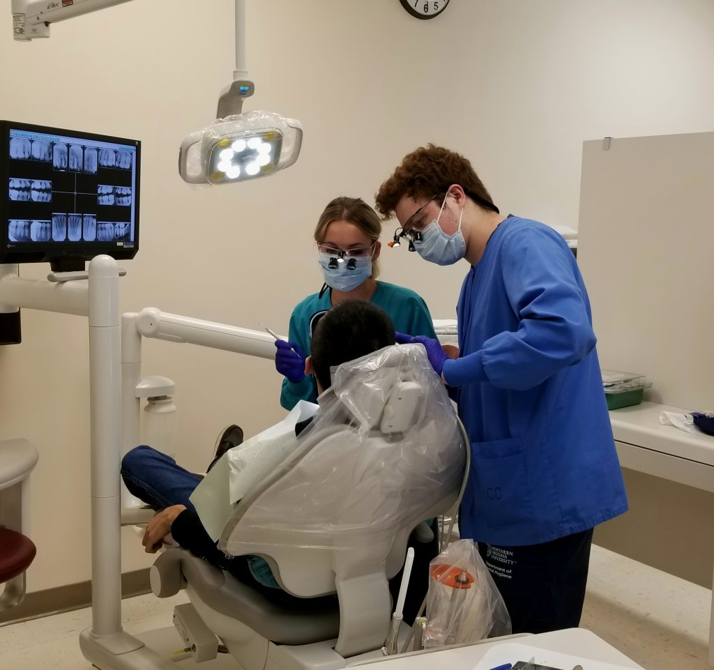 Britney White and Logan Toner providing dental cleaning at Hopi Health Care Center