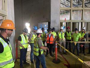 Construction management students on job site