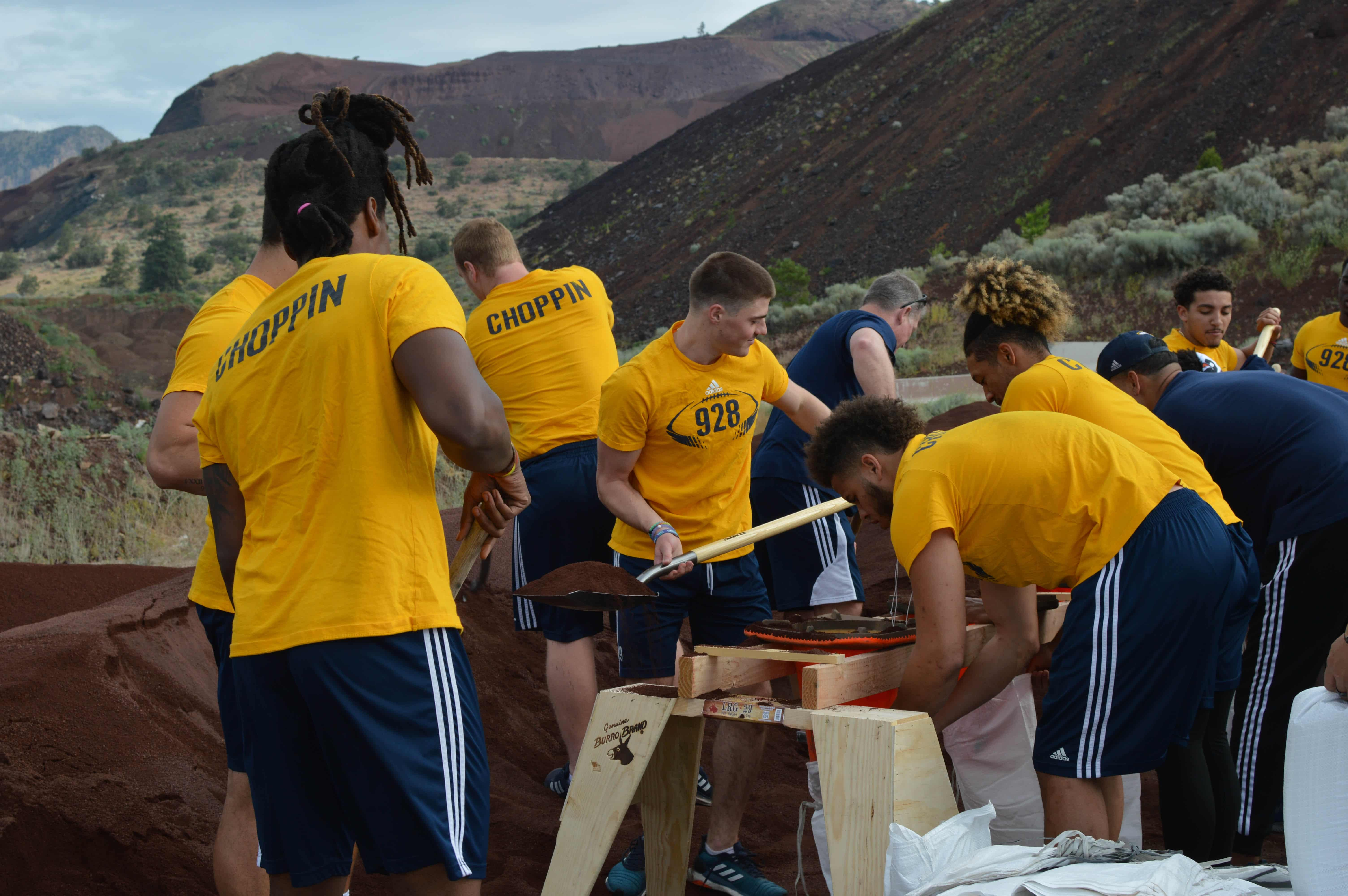 NAU student-athletes fill sandbags
