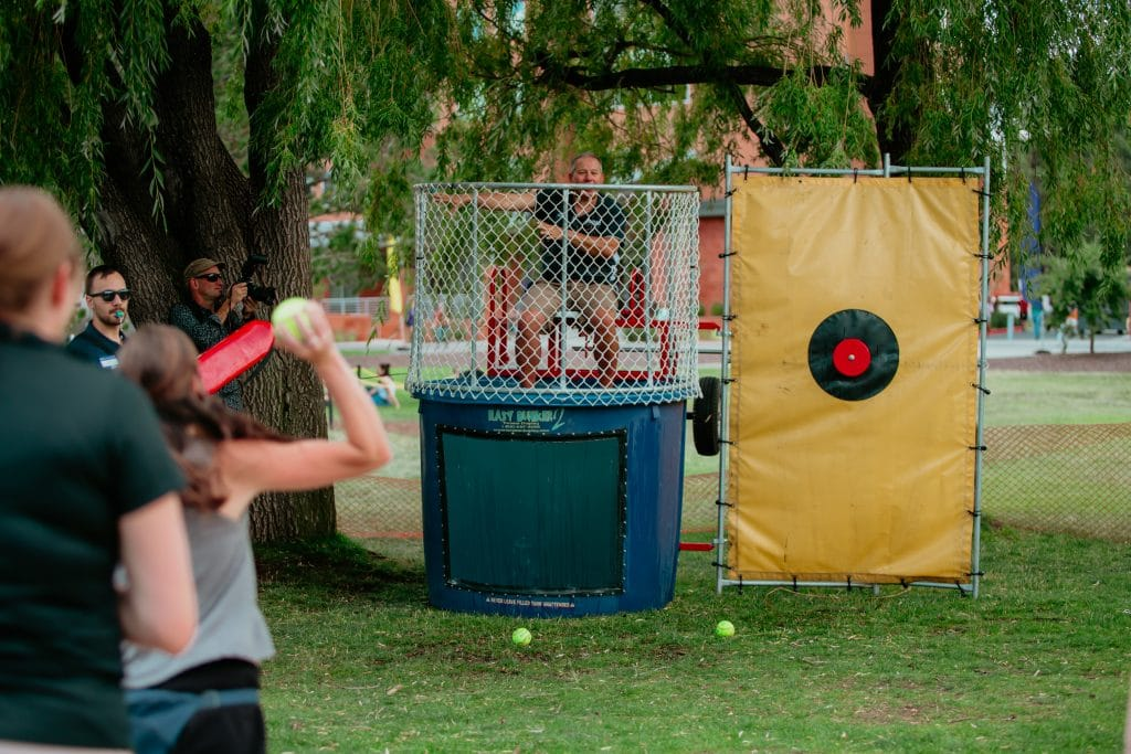 Participant in the Dunk Tank about to throw the ball
