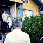 Volunteers greet neighbors