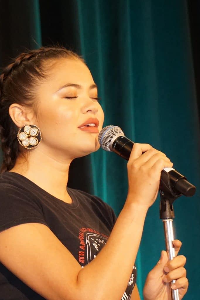 Ta'Kaiya singing