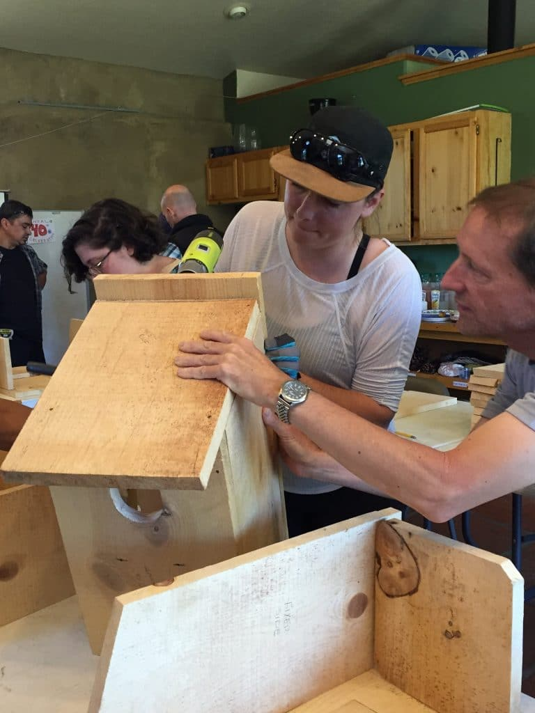Community members working on nestboxes